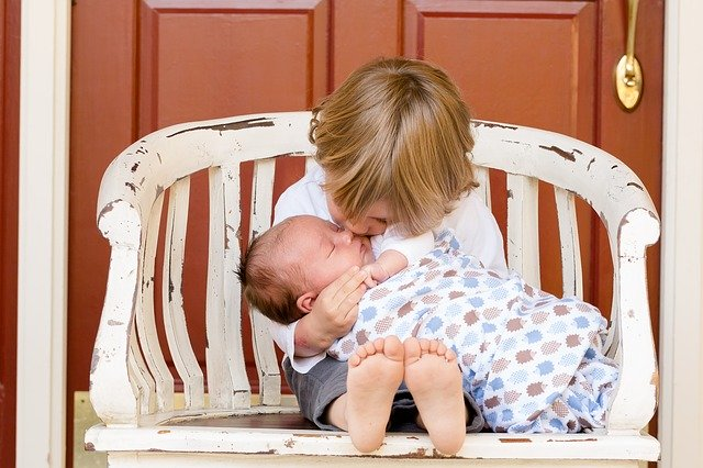 Girl kissing baby