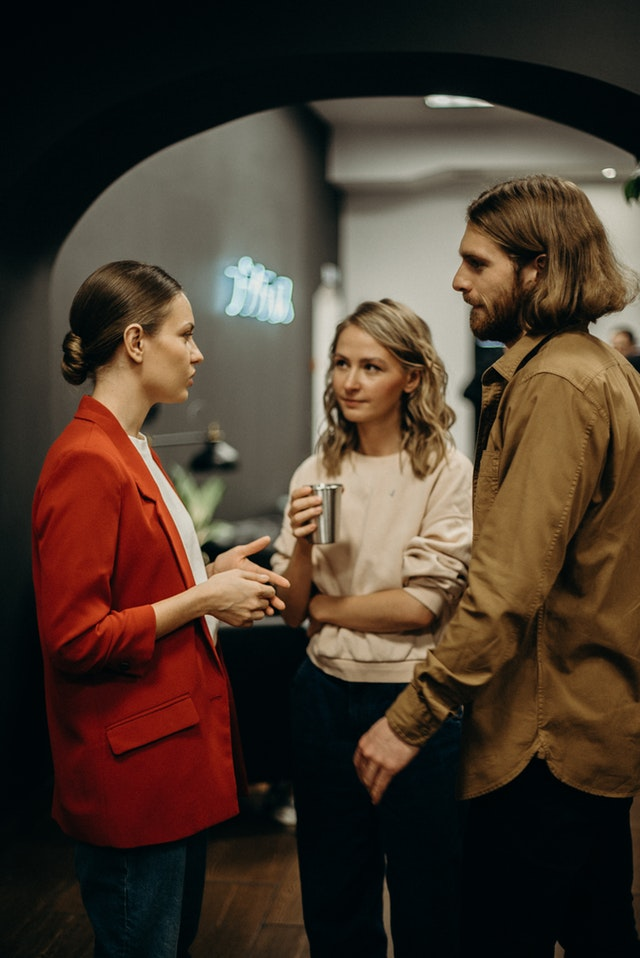 two-women-and-man-talking